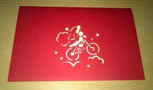Weihnachtsmann auf dem Fahrrad